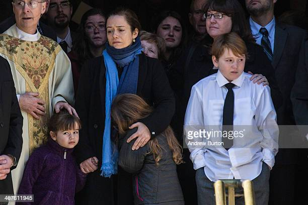 Mimi O'Donnell partner of actor Philip Seymour Hoffman along with their children Willa Hoffman Tallulah Hoffman and Cooper Hoffman watch as the...