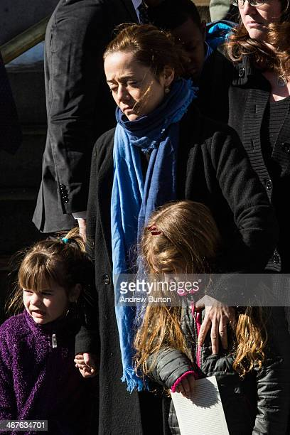 Mimi O'Donnell partner of actor Philip Seymour Hoffman along with their daughters Willa Hoffman and Tallulah Hoffman watch as the casket carrying...