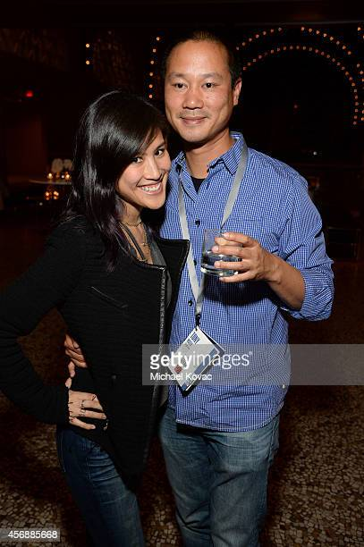Mimi Pham and Zapposcom CEO Tony Hsieh attend the Vanity Fair New Establishment Summit Cockatil Party on October 8 2014 in San Francisco California