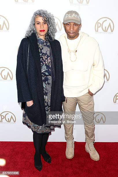 Mimi Valdes and producer/musician Pharrell Williams attend the 28th Annual Producers Guild Awards at The Beverly Hilton Hotel on January 28 2017 in...