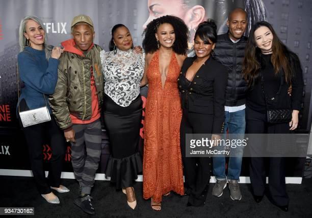Mimi Valdes Pharrell Williams Roxanne Shante Chante Adams Nia Long Michael Larnell and Nina Yang Bongiovi attend a special screening of the Netflix...