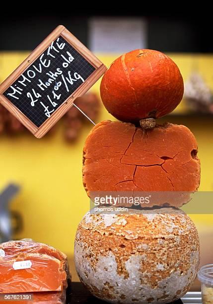 Mimolette and mini pumpkin at a market stall