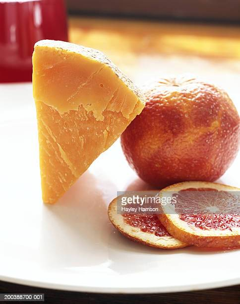 Mimolette Cheese and blood orange on plate, close-up