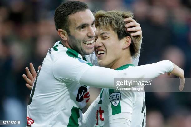Mimoun Mahi of FC Groningen celebrates 32 with Ritsu Doan of FC Groningen during the Dutch Eredivisie match between FC Groningen v Vitesse at the...