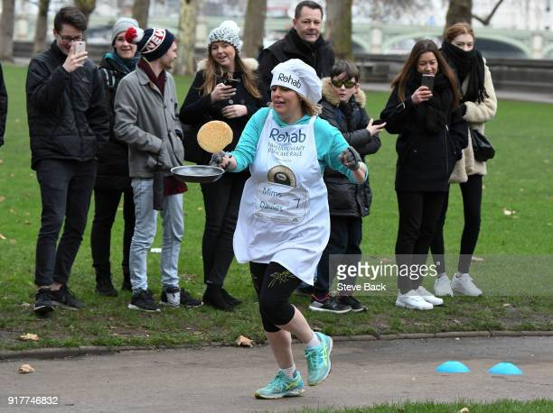 Mims Davis MP approachess the second corner in the annual Parliamentary Pancake Race in Victoria Tower Gardens on Shrove Tuesday on February 13 2018...