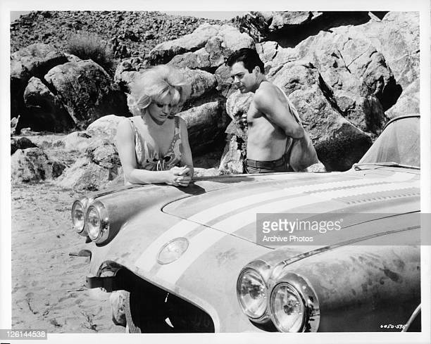 Mimsy Farmer and Paul Bertoya reflect for a moment in a scene from the film 'Hot Rods To Hell' 1966
