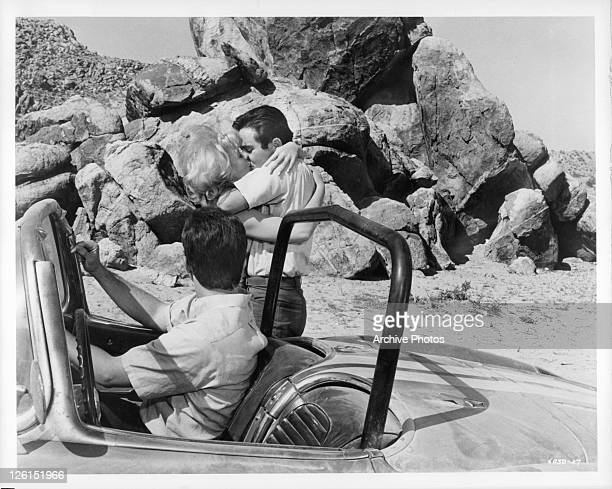 Mimsy Farmer goes for a kiss while Paul Bertoya is in the drivers seat in a scene from the film 'Hot Rods To Hell' 1966