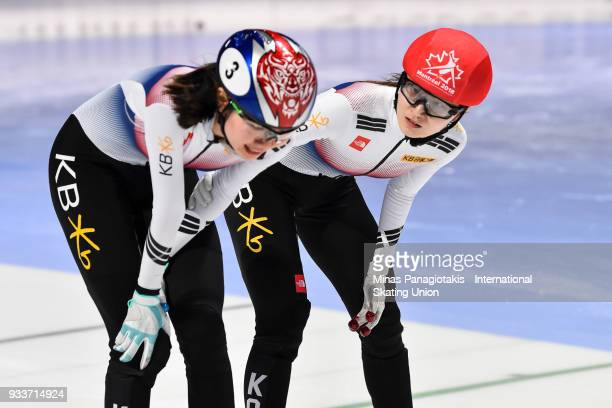 Min Jeong Choi of Korea comforts teammate Suk Hee Shim of Korea after finishing first in the women's 1000 meter Final during the World Short Track...