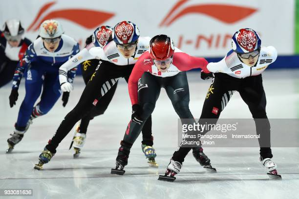 Min Jeong Choi of Korea takes the lead over Kim Boutin of Canada in the women's 1500 meter finals during the World Short Track Speed Skating...