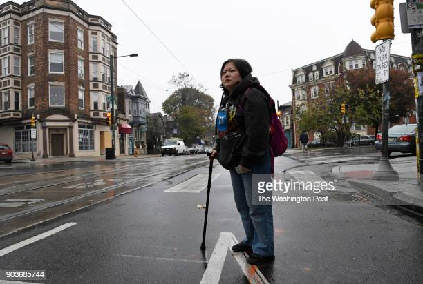 Min Jung of Philadelphia PA waits for a trolley to go to her physical therapy appointment in Philadelphia on November 13 2017 Min suffers from...