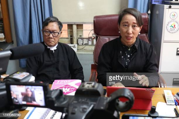 Min Min Soe and Khin Maung Zaw , lawyers representing detained Myanmar leader Aung San Suu Kyi, address members of the media at Khin Maung Zaw's...