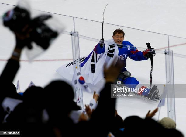 Min Su Han of Korea celebrates with the crowd after winning the bronze medal against Italy the Ice Hockey bronze medal game between Korea and Italy...