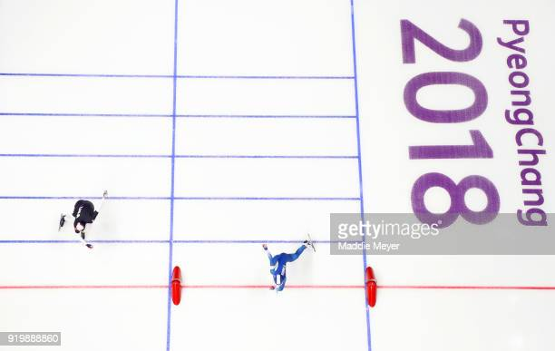 Min Sun Kim of Korea and Heather Bergsma of the United States race for the line during the Ladies' 500m Individual Speed Skating Final on day nine of...