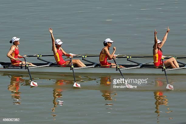 Min Wang, Xiaoxing Shen, Yuwei Wang and Xinyue Zhang of China celebrate after claiming the Gold medal following the Women's Quadruple Sculls Final...