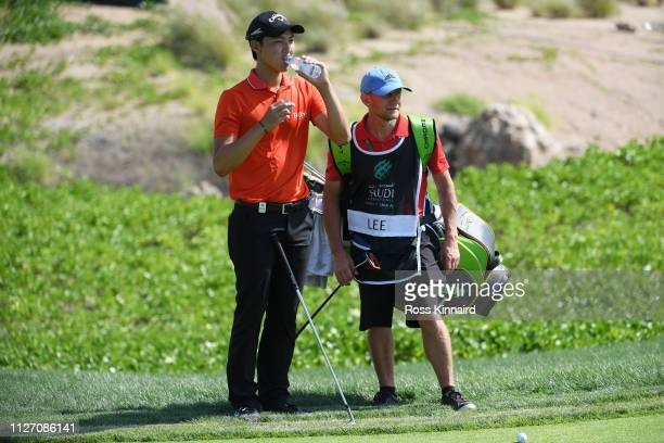 Min Woo Lee of Australia and his caddie on the seventh hole during Day four of the Saudi International at the Royal Greens Golf Country Club on...