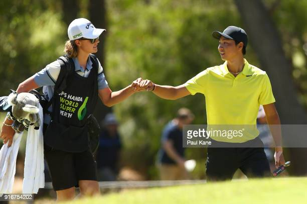 Min Woo Lee of Australia fist bumps his caddie while walking to the 6th green in the round 2 match agaiunst Prom Meesawat of Thailand during day four...