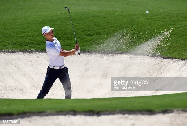 Min Woo Lee of Australia hits out of a bunker during the third round of the Australian Open played at the Australian Golf Club course in Sydney on...