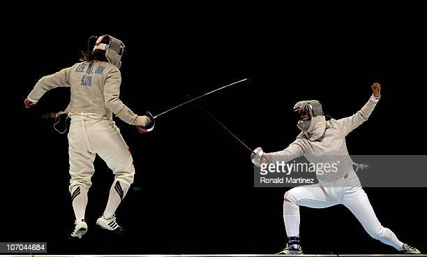 Min Zhu of China competes in the Women's Team Sabre Final against Rajin Lee of South Korea at Guangda Gymnasium during day nine of the 16th Asian...
