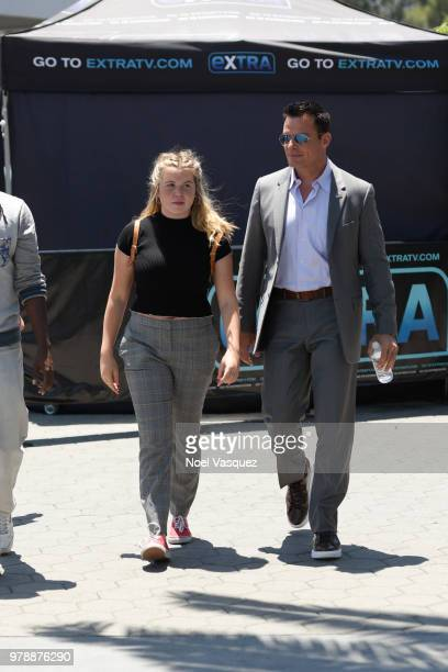 Mina Bree Sabato and Antonio Sabato Jr visit Extra at Universal Studios Hollywood on June 19 2018 in Universal City California
