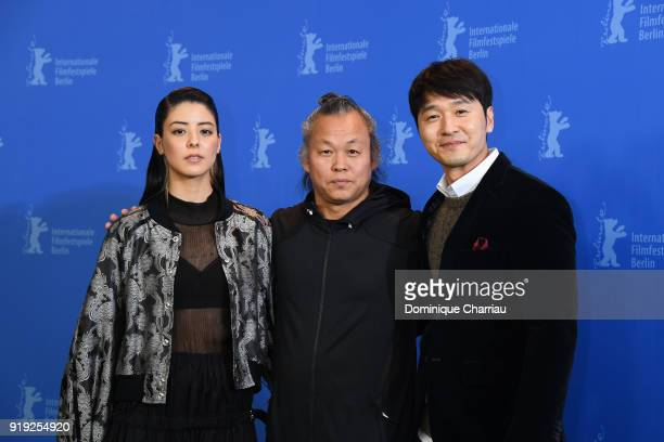 Mina Fujii, Kim Ki-duk and Lee Sung-jae pose at the 'Human, Space, Time and Human' photo call during the 68th Berlinale International Film Festival...