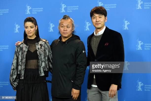 Mina Fujii Kim Kiduk and Lee Sungjae pose for a photo during a photocall on the film Human Space Time and Human' during the 68th Berlinale...
