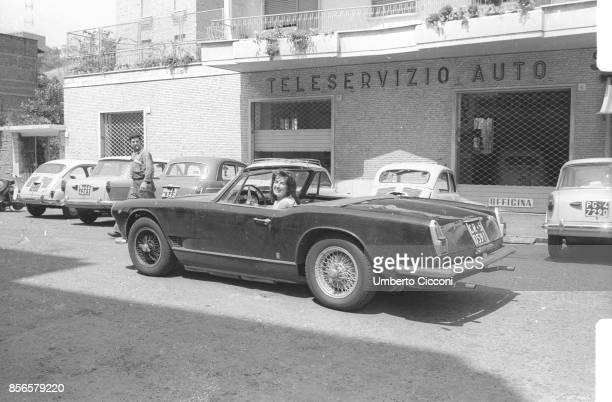 Mina Mazzini a famous Italian singer in a vintage car in Rome in 1962