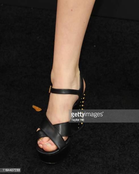 "Mina Sundwall, shoe detail, attends the ""Orange is the New Black"" final season world premiere at Alice Tully Hall, Lincoln Center on July 25, 2019 in..."