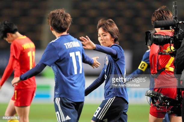 Mina Tanaka and Mana Iwabuchi of Japan celebrate their 10 victory in the EAFF E1 Women's Football Championship between Japan and China at Fukuda...