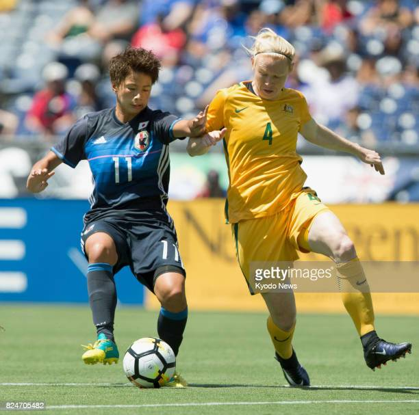 Mina Tanaka of Japan and Clare Polkinghorne of Australia compete for the ball in the first half of a Tournament of Nations game in San Diego on July...