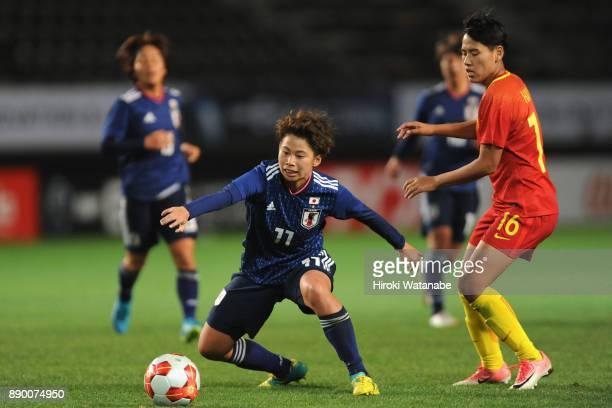 Mina Tanaka of Japan and Han Peng of China compete for the ball during the EAFF E1 Women's Football Championship between Japan and China at Fukuda...
