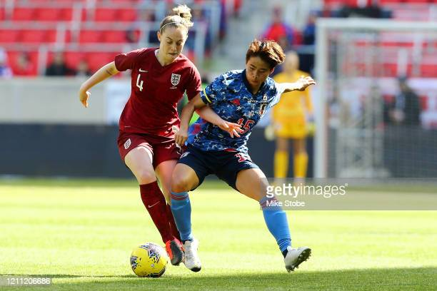 Mina Tanaka of Japan and Keira Walsh of England vie for the ball at Red Bull Arena on March 08, 2020 in Harrison, New Jersey.