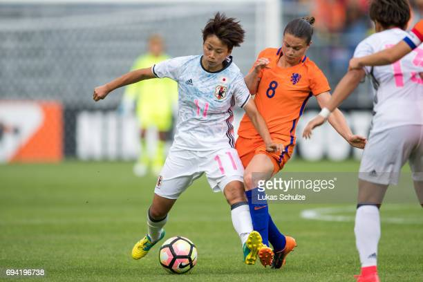Mina Tanaka of Japan and Sherida Spitse of Netherlands fight for the ball during the Women's International Friendly match between Netherlands and...