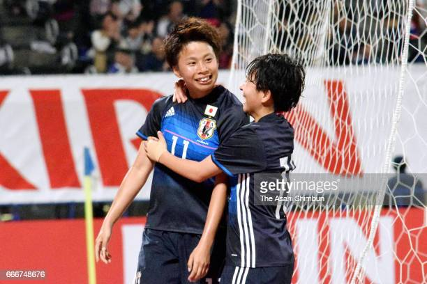 Mina Tanaka of Japan celebrates scoring her side's second goal with her team mate Yuka Momiki during the international friendly match between Japan...
