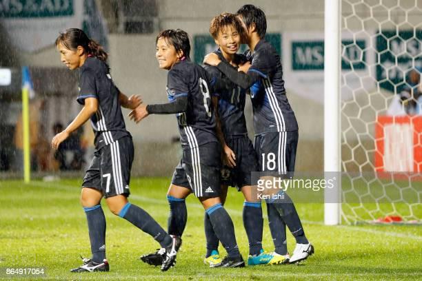 Mina Tanaka of Japan celebrates scoring her side's second goal with her team mates Emi Nakajima Mana Iwabuchi and Mami Ueno during the international...