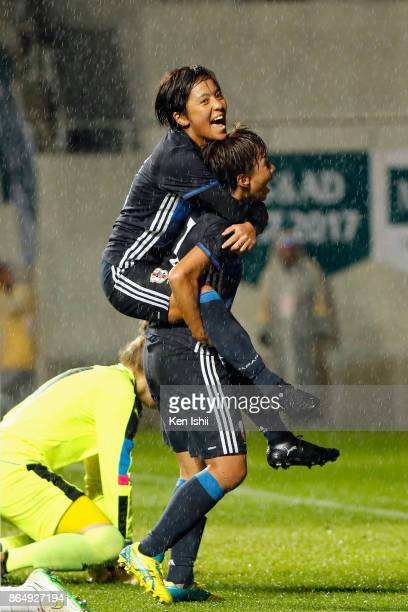 Mina Tanaka of Japan celebrates scoring her side's second goal with her team mate Mana Iwabuchi during the international friendly match between Japan...