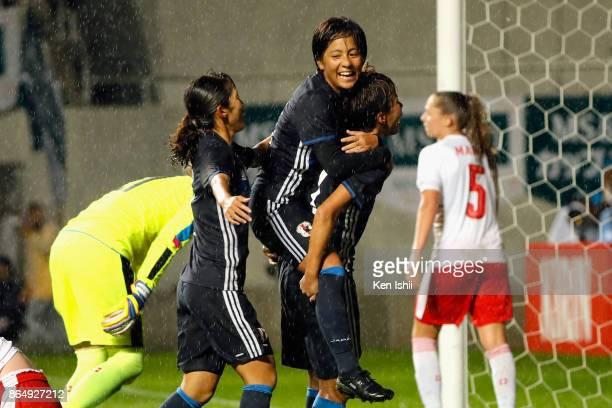 Mina Tanaka of Japan celebrates scoring her side's second goal with her team mates Mana Iwabuchi and Emi Nakajima during the international friendly...