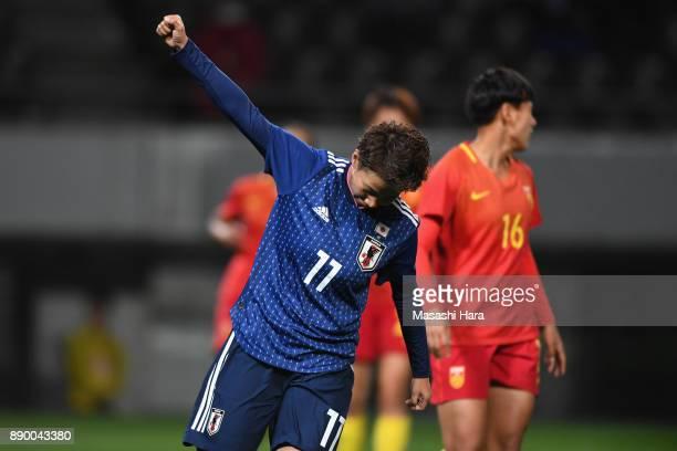 Mina Tanaka of Japan celebrates scoring the opening goal during the EAFF E-1 Women's Football Championship between Japan and China at Fukuda Denshi...