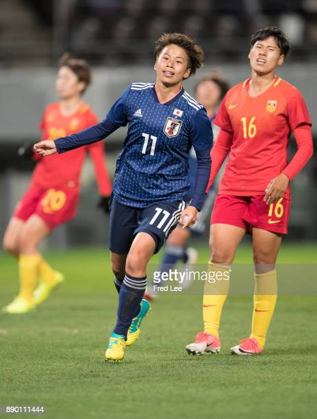 Mina Tanaka of Japan celebrates scoring the opening goal during the EAFF E1 Women's Football Championship between Japan and China at Fukuda Denshi...