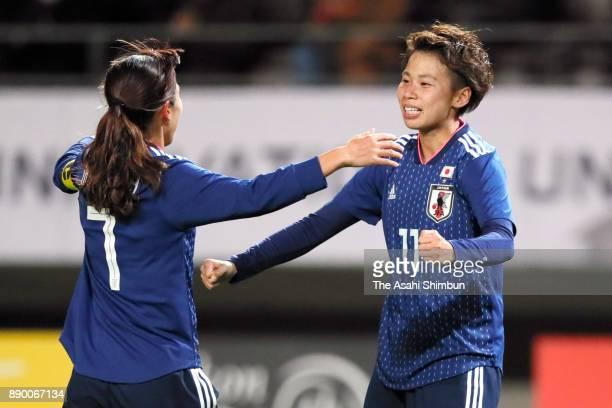 Mina Tanaka of Japan celebrates scoring the opening goal with her team mate Emi Nakajima during the EAFF E1 Women's Football Championship between...