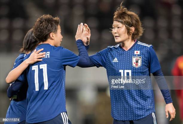 Mina Tanaka of Japan celebrates scoring the opening goal with her team mate Sakaguchi Mizuho of Japan during the EAFF E1 Women's Football...