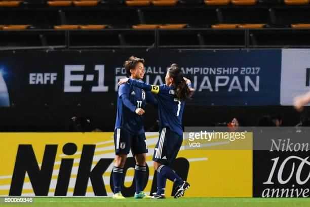 Mina Tanaka of Japan celebrates with team mate after scoring her team's first goal during the EAFF E1 Women's Football Championship between Japan and...