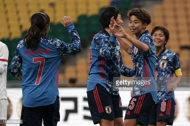 Mina Tanaka of Japan celebrates with team mate Emi Nakajima after scoring the goal during the EAFF E-1 Football Championship match between Japan and...