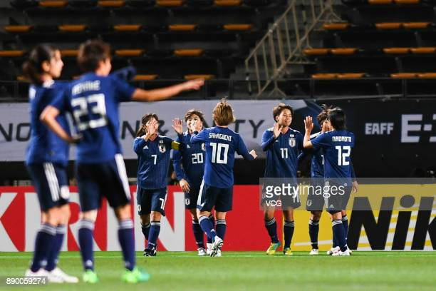 Mina Tanaka of Japan celebrates with team mates after scoring her team's first goal during the EAFF E1 Women's Football Championship between Japan...