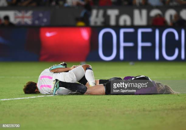 Mina Tanaka of Japan collies with Alyssa Naeher of USA as she attempted a shot on goal during the Tournament of Nations soccer match between USA and...