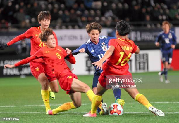 Mina Tanaka of Japan controls the ball under pressure of Chinese defense during the EAFF E1 Women's Football Championship between Japan and China at...