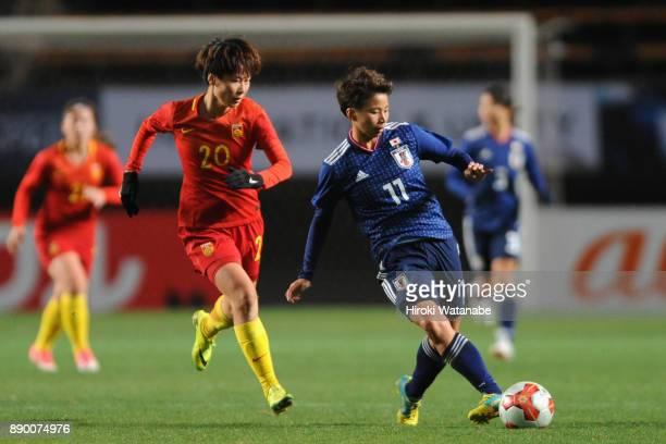 Mina Tanaka of Japan controls the ball under pressure of Zhang Rui of China during the EAFF E1 Women's Football Championship between Japan and China...