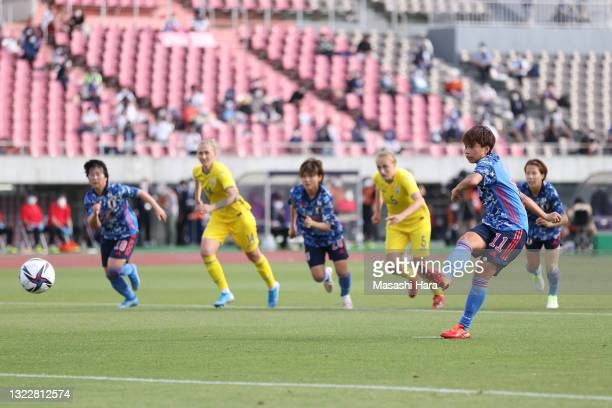Mina Tanaka of Japan converts the penalty to score her side's seventh goal during the women's international friendly match between Japan and Ukraine...