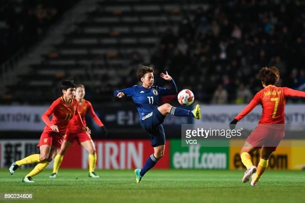 Mina Tanaka of Japan drives the ball during the EAFF E1 Women's Football Championship between Japan and China at Fukuda Denshi Arena on December 11...