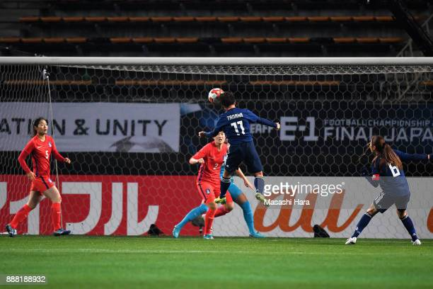 Mina Tanaka of Japan heads the ball to score the opening goal during the EAFF E-1 Women's Football Championship between Japan and South Korea at...