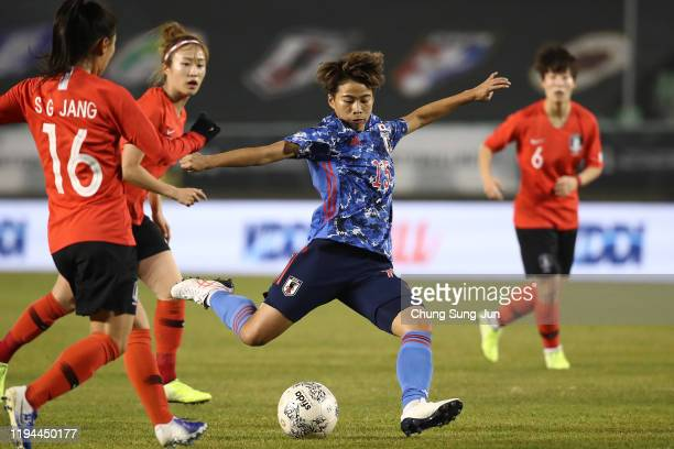 Mina Tanaka of Japan in action during the EAFF E-1 Football Championship match between South Korea and Japan at Busan Gudeok Stadium on December 17,...